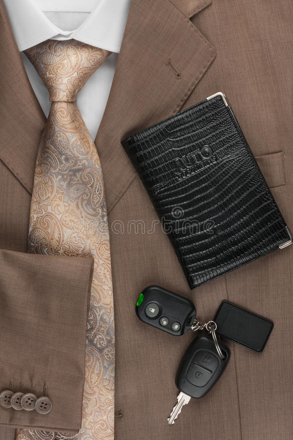 Driver's license and car keys lying on the jacket. Can be used as background stock images