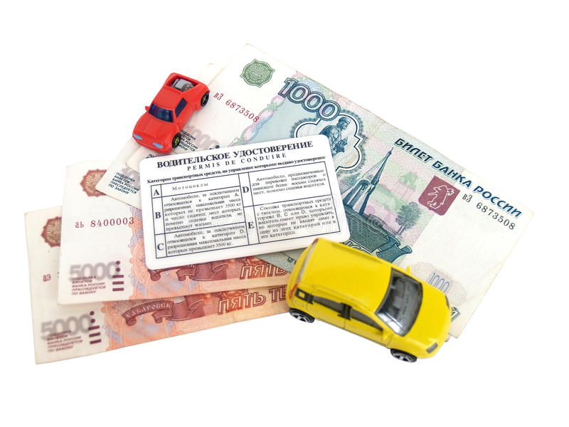 Driver's license, Russian money and models of cars.  stock photography