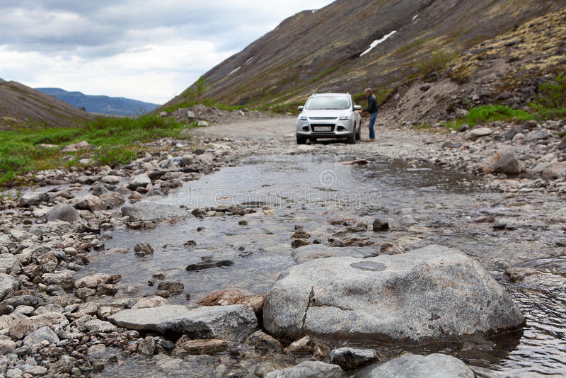 Driver sitting in car for driving on mountains river stock image
