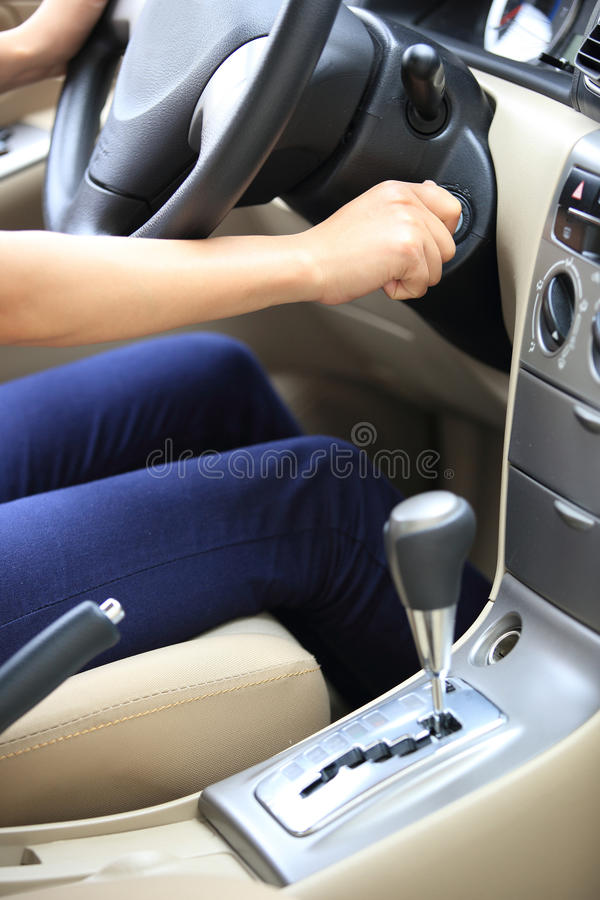Driver starting the car. Woman driver starting the car before driving royalty free stock photos