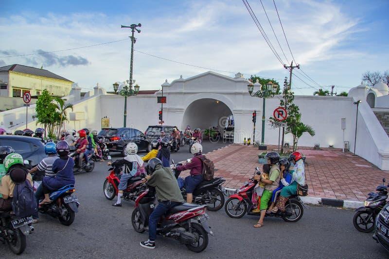 Driver stop in red traffic lights on plengkung gading yogyakarta. Yogyakarta, Indonesia - april 2, 2019 royalty free stock photo