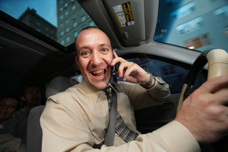 Driver talking cell phone. Businessman driving in car and talking cell phone stock images