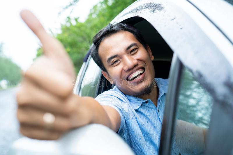Driver taxi online smile and showing thumb up look at camera royalty free stock photos
