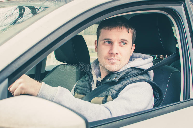 Driver thinking inside the car. Safe driving stock photography