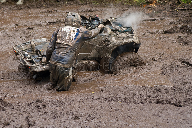 Download Driver And Vehicle In Mud Stock Photo - Image: 6690800