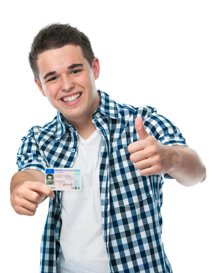 Drivers license. Happy teenager showing his driving license royalty free stock photography