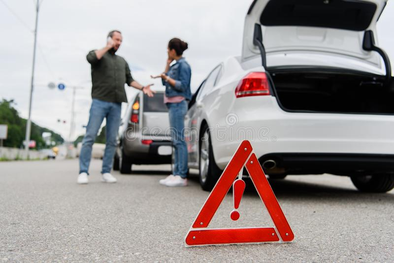Drivers talking on road with red stop sign. On foreground stock photos