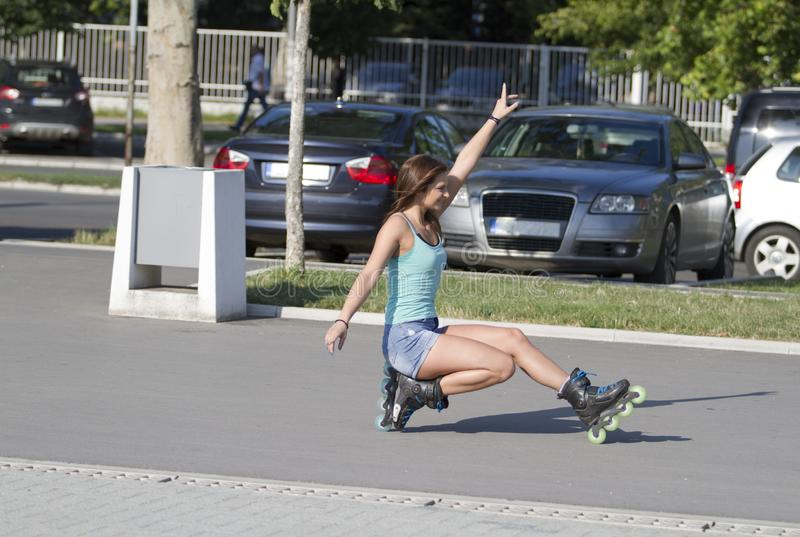 Drives the inline skate in the lowered position.Girl inline skate. Beautiful girl. Drives the inline skate in the lowered position.Novi Sad royalty free stock image