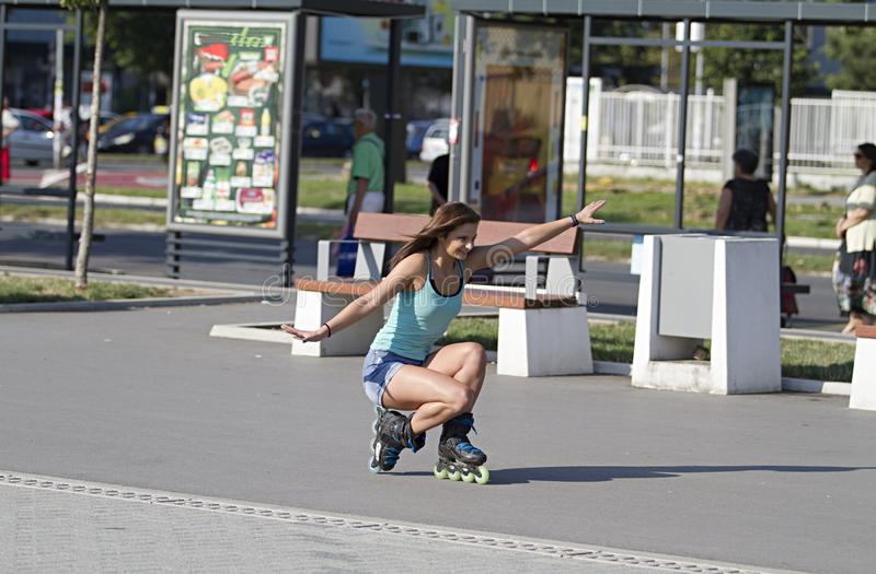 Drives the inline skate in the lowered position.Girl inline skate.Novi Sad. Beautiful girl. Drives the inline skate in the lowered position royalty free stock photos