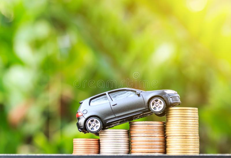 Drives on roll ladder of gold coins money. Drives on roll ladder of gold coins money on wood table stock photos