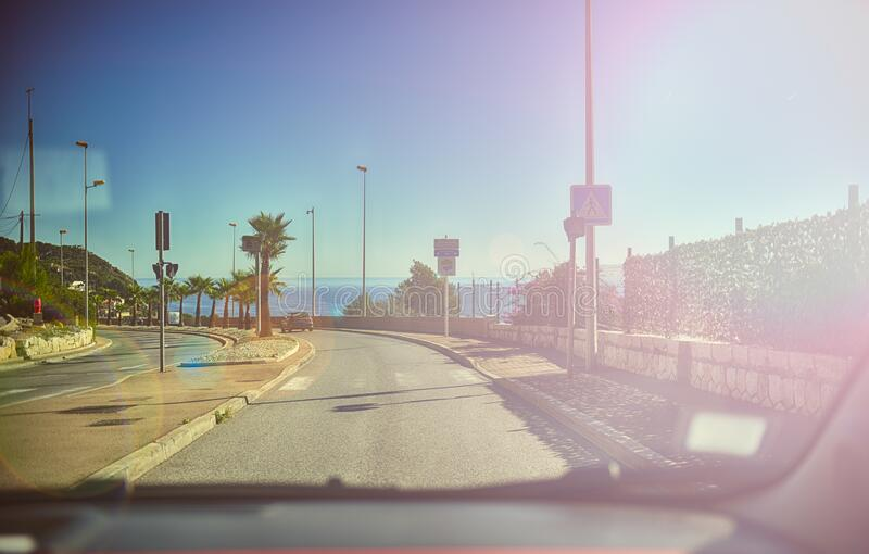 Driving along an ocean road royalty free stock image