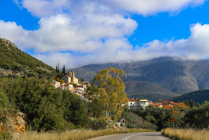 Driving into a beautiful mountain village in the Taygetos mountain range south of Kalamata Greece on the Peloponnese peninsula. Mpuntains and clouds royalty free stock images