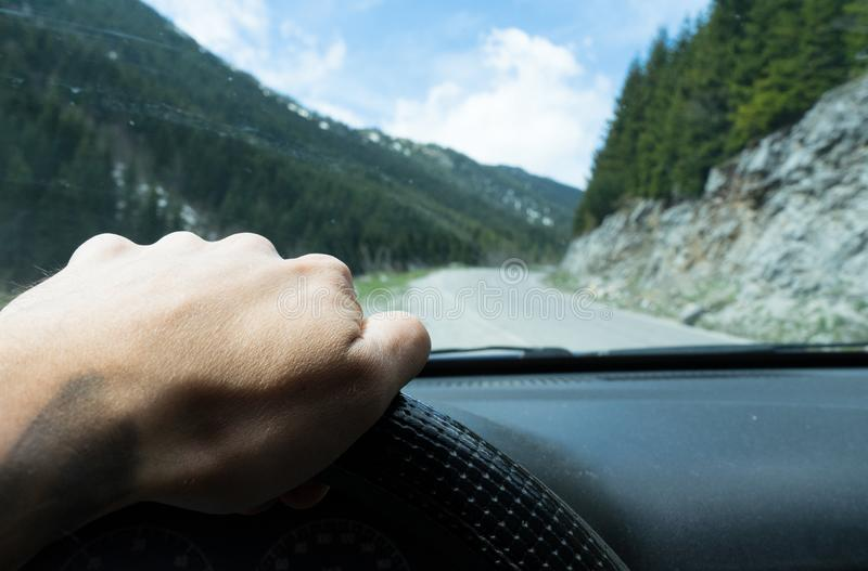 Driving car on the mountain road. Montenegro in a cheap car. Rental active holding person tree back trip light control steering male view panel safety front stock photo