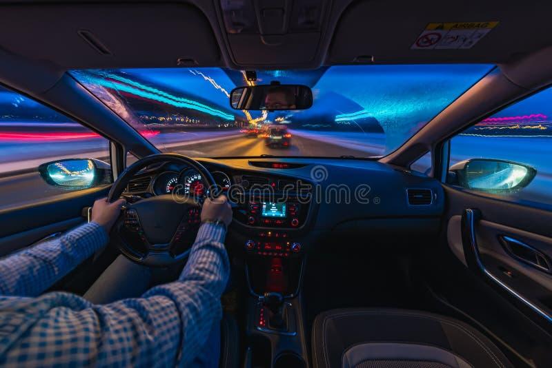 Car driving at night stock photography