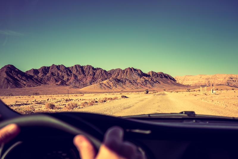 Driving a car on the road in the desert stock photos