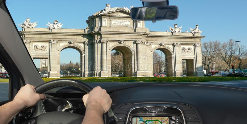 Driving a car towards Alcala Gate in Madrid, Spain stock photography