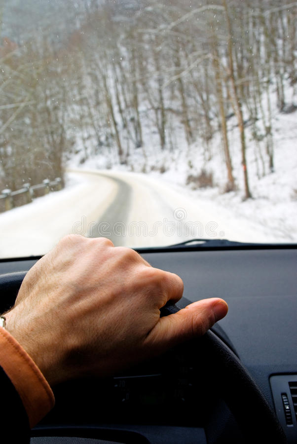 Driving car on winter road royalty free stock photo