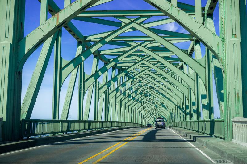 Driving on the Conde B. McCullough Memorial Bridge, Oregon, formerly the Coos Bay Bridge, on a sunny day stock photography