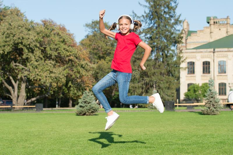Driving dancer excellence. Little dancer perform leap on green grass. Cute girl dancer dancing energetic dance. Adorable. Small dancer jump to music playing in royalty free stock photos
