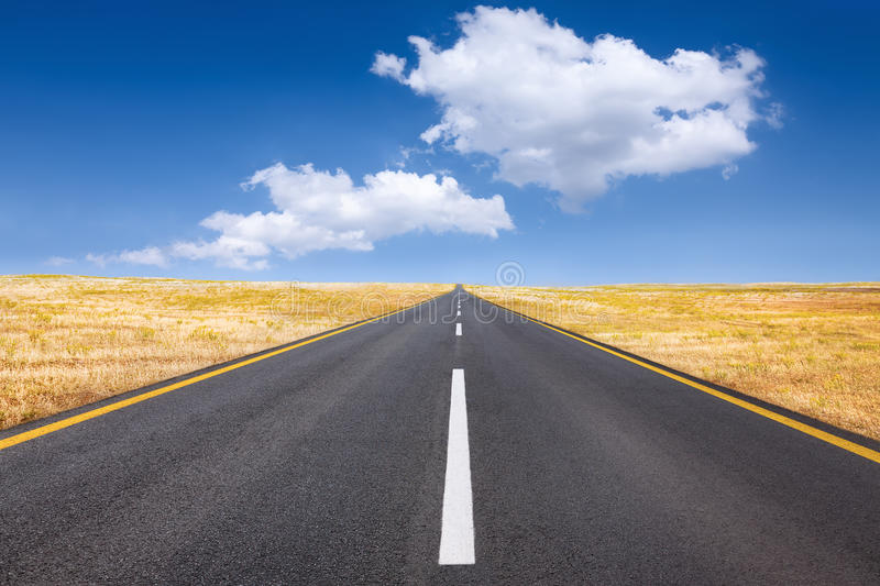 Driving on an empty road at bright sunny day. Carefree driving on a bright sunny day stock photo