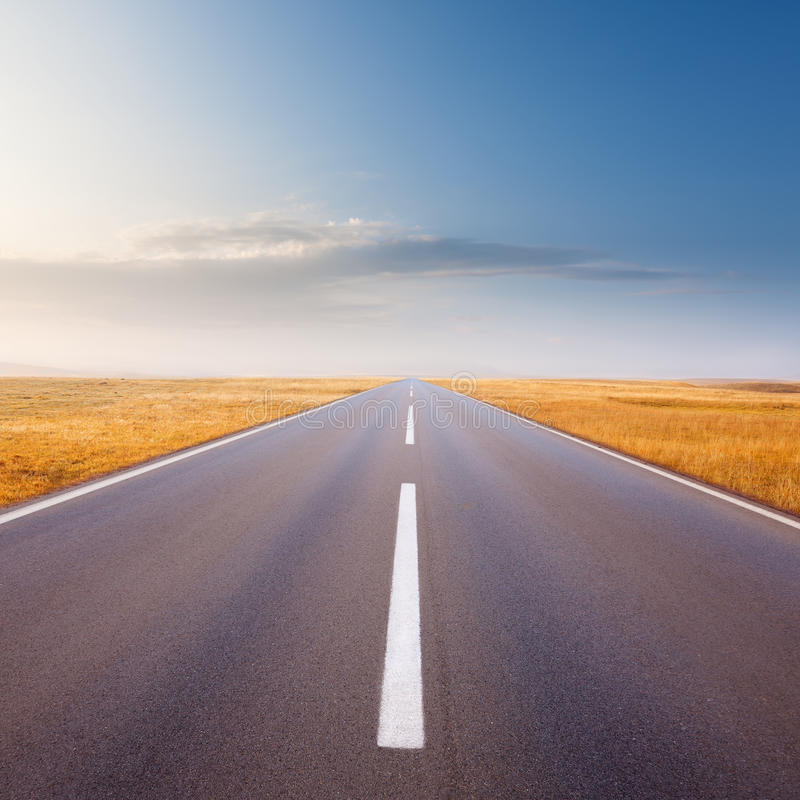 Driving on an empty road at bright sunny day. Carefree driving on a sunny day stock images