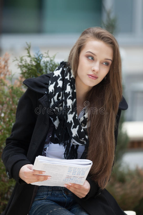 Driving exam preparations. Beautiful girl preparing for the driving exam stock photo