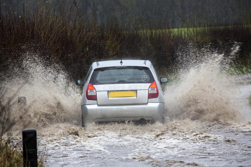 Driving on a flooded country road stock photo
