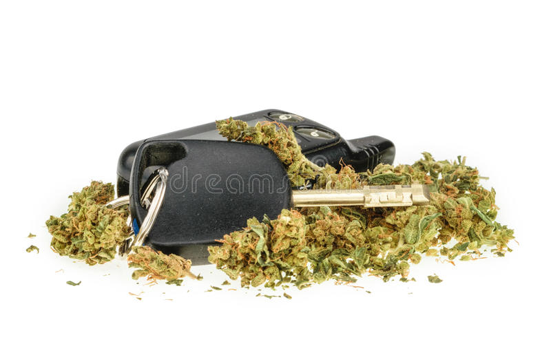 Driving high, marijuana and car key isolated on white.  royalty free stock photo