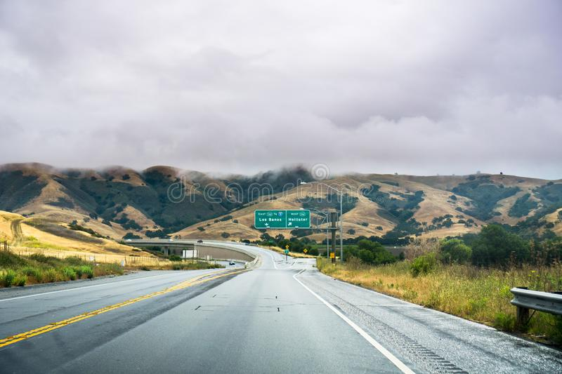 Driving on the highway through the hills of south San Francisco bay area on a cloudy day, California royalty free stock image