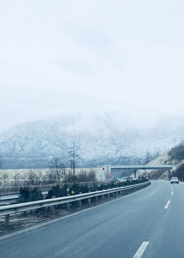 Driving on the highway in snowy days stock photography