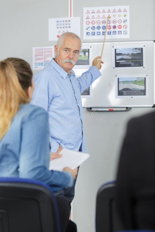 Driving instructor in class stock photography