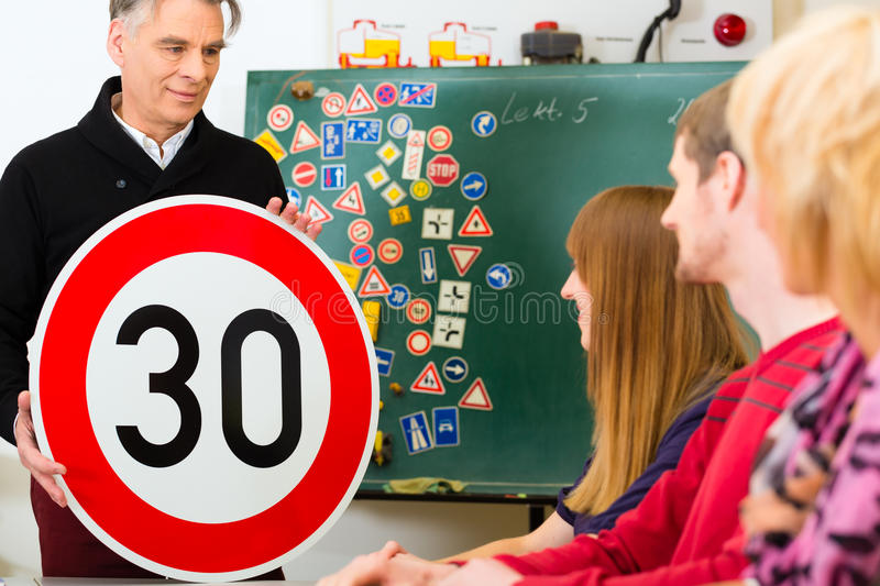 Driving instructor with his class stock photo