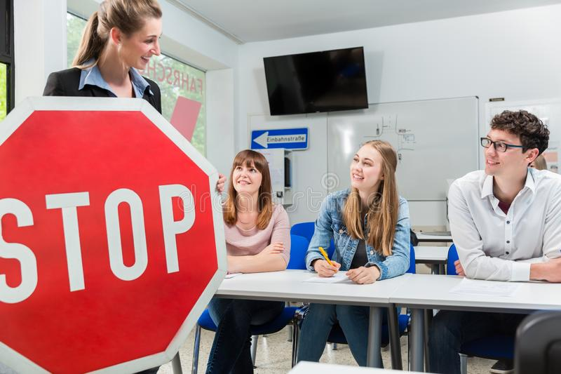 Driving instructor holding theoretical part of driving lessons royalty free stock image