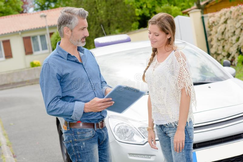 Driving instructor teaching student learner driver stock image