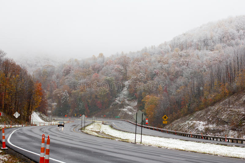 Driving in the late fall through West Virginia. Highway 77 in late fall with snow and rain stock photo
