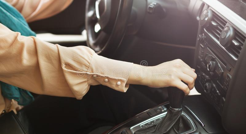 Driving license test concept. Woman shifting gear stick in car. Driving license test concept stock images