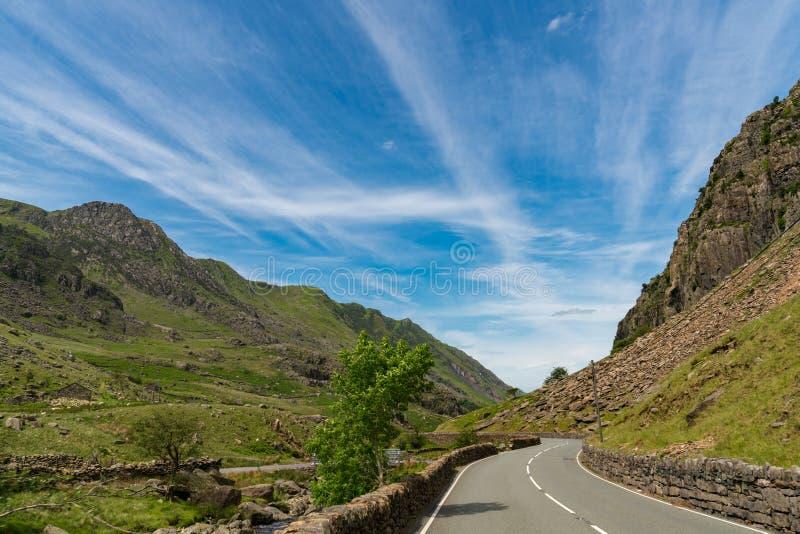 Driving on the A4086 near Llanberis, Gwynedd, Wales, UK. Driving on the road to Llanberis, with Crib Goch on the left, Snowdonia, Gwynedd, Wales, UK royalty free stock photos