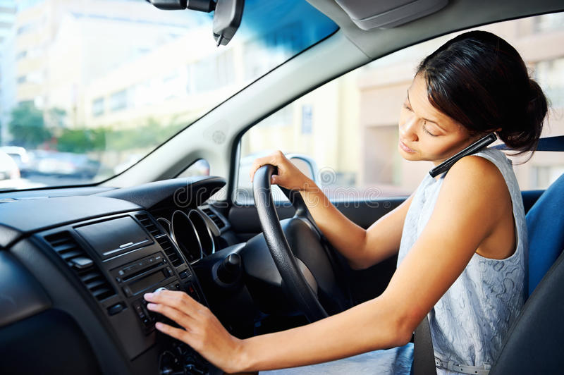 Driving phone woman stock photos