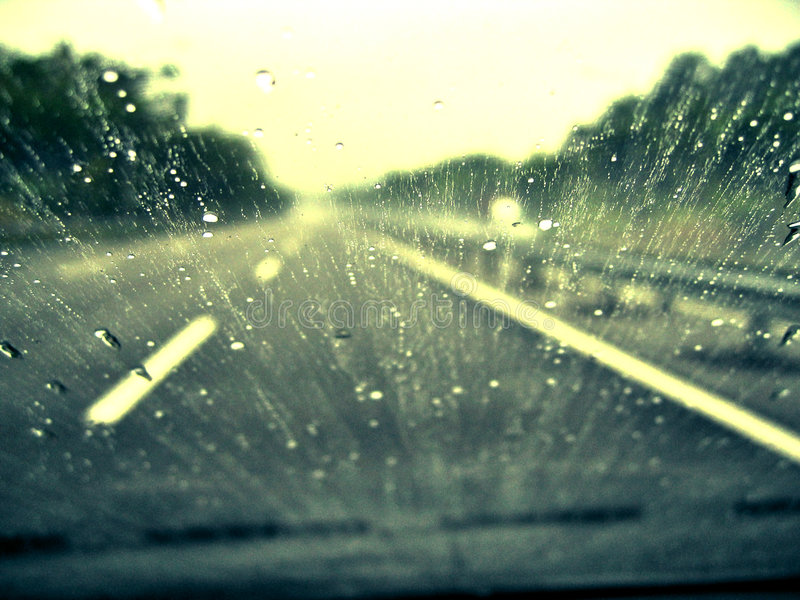 Driving In The Rain. Rain droplets on the windscreen with grungy colors