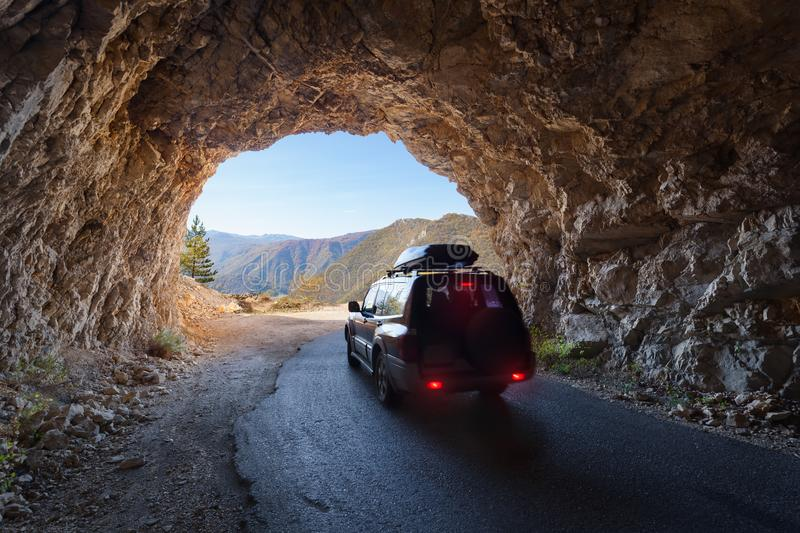 Driving through road tunnel at beautiful Piva canyon in Montenegro royalty free stock images