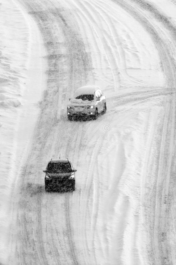 Driving on Snow and Snowy Roads in Winter Blizzard stock photos