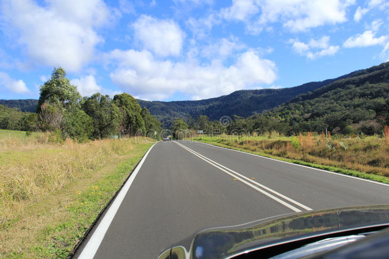 Driving on straight road. Pleasant drive on smooth straight road in countryside in NSW Australia royalty free stock photography