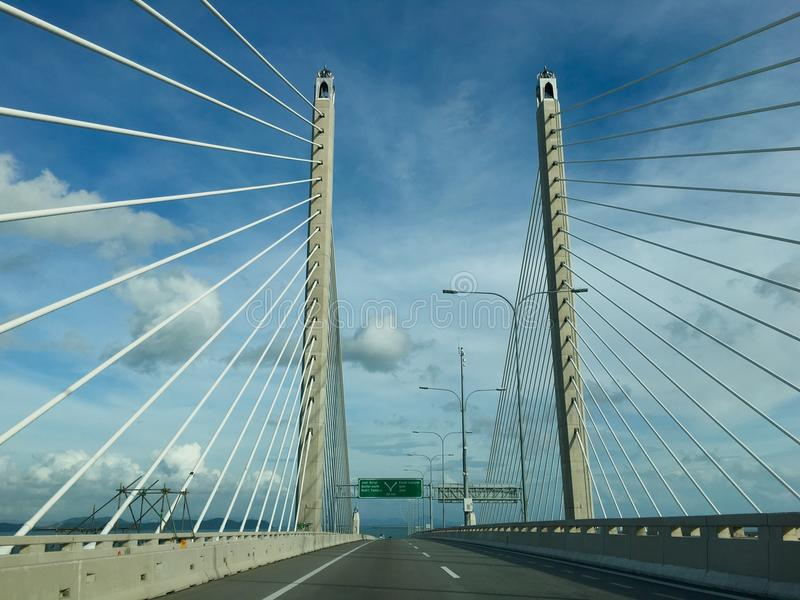 Driving on Sultan Abdul Halim Muadzam Shah Bridge at Penang Island. This is Penang second bridge with length distance of 24 kilometres opened in year 2014. It is royalty free stock photos