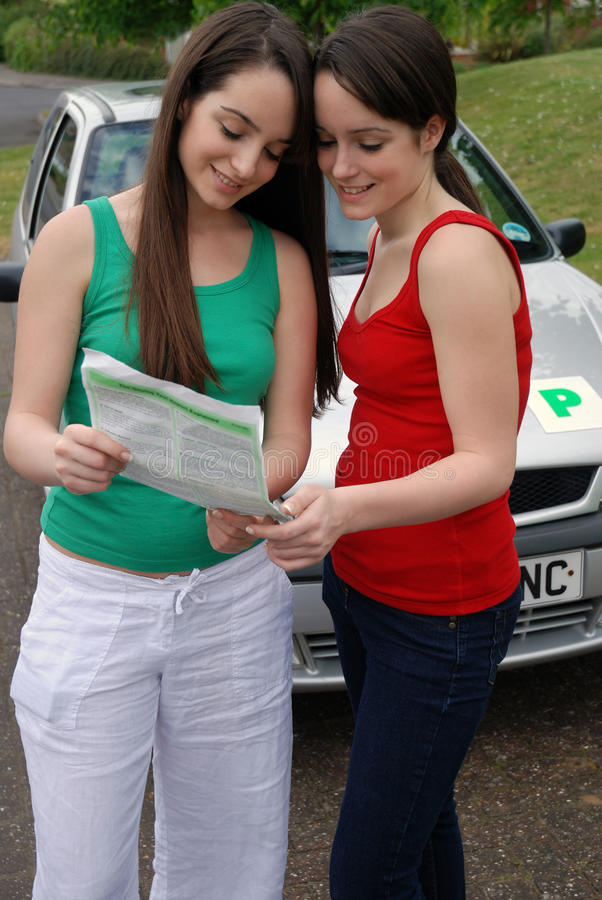 Driving test. Young teenagers looking at driving test results royalty free stock images