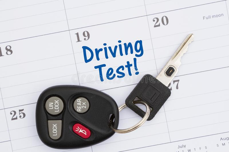 Driving test message with monthly calendar with car keys. And fob stock images