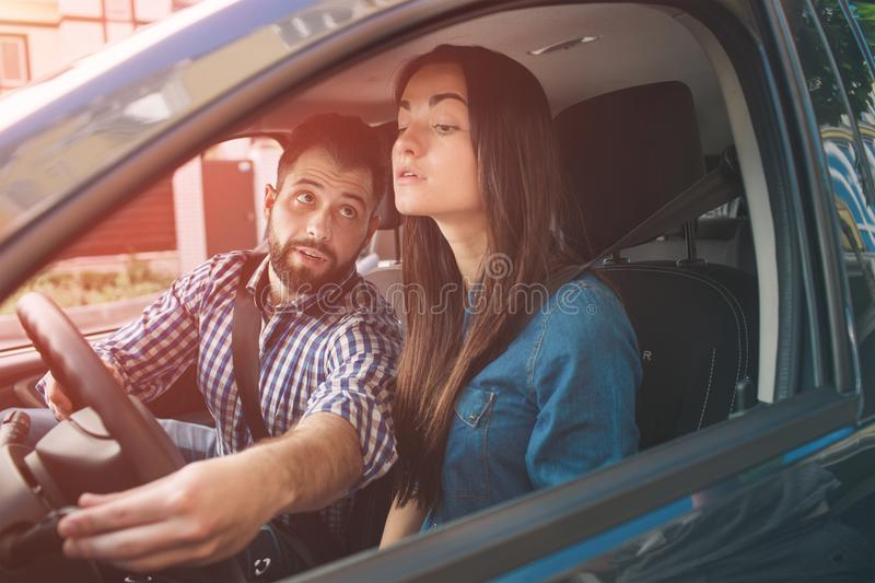 Driving test. Young serious woman driving car feeling inexperienced, looking nervous at the road traffic for information. Driving test. Young serious women royalty free stock images