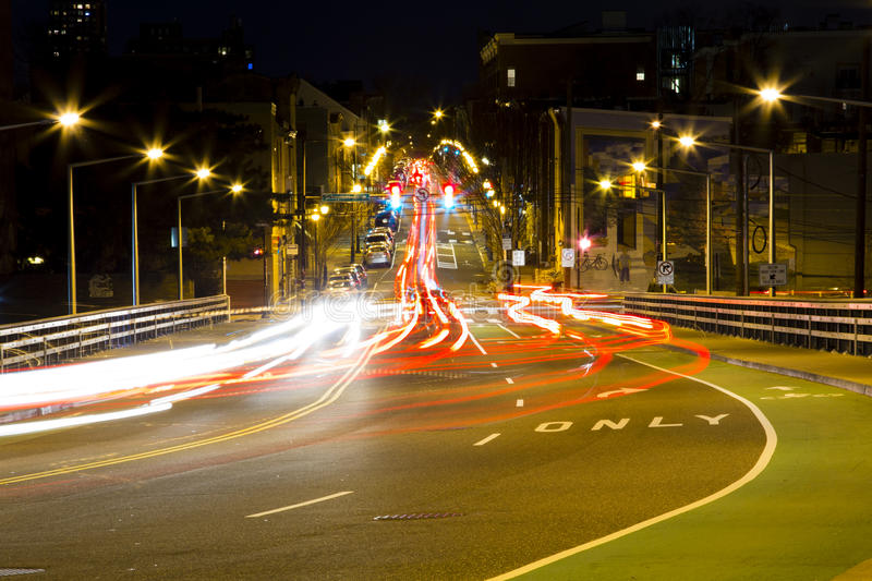 Driving thru busy intersection at night royalty free stock image