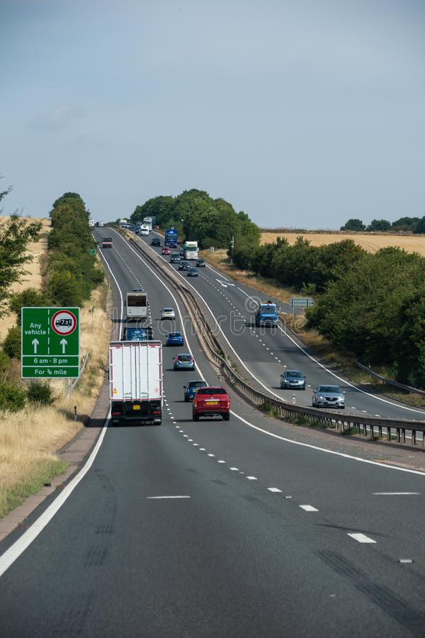 Driving up that hill. East Ilsley, United Kingdom - August 07 2018: Traffic driving up and down a long hill on the A34 royalty free stock photos