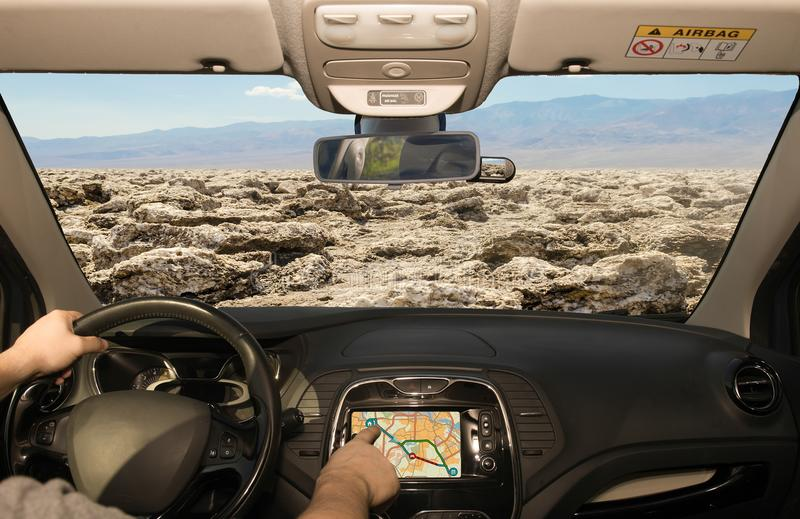 Driving using GPS towards Devil& x27;s Golf Course, Death Valley, USA royalty free stock image