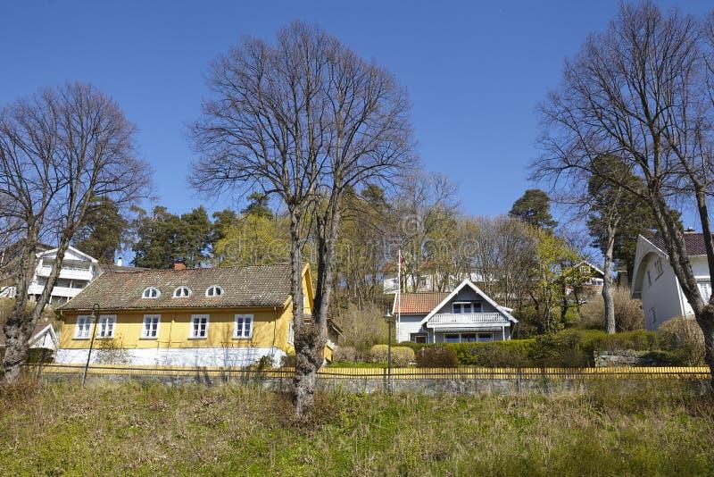 Drobak Noruega, Askershus - fila de casas imágenes de archivo libres de regalías